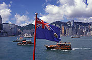 The British Hong Kong flag flies over Hong Kong harbour for the last few hours, on the eve of the handover of sovereignty from Britain to China, on 30th June 1997, in Hong Kong, China.  Midnight signified the end of British rule, and the transfer of legal and financial authority back to China. Hong Kong was once known as fragrant harbour or Heung Keung because of the smell of transported sandal wood.
