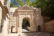 Historic archway spanning road, Puerta de los Granadas, Granada, Spain
