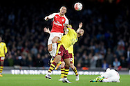 Andre Gray of Burnley elbows Kieran Gibbs of Arsenal in the stomach as both players go for the ball. The Emirates FA cup, 4th round match, Arsenal v Burnley at the Emirates Stadium in London on Saturday 30th January 2016.<br /> pic by John Patrick Fletcher, Andrew Orchard sports photography.
