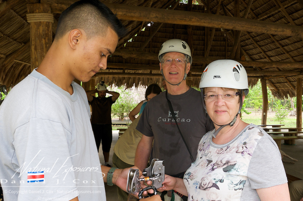 Tom and Heather get geared up for the zip line ride. Costa Rica.
