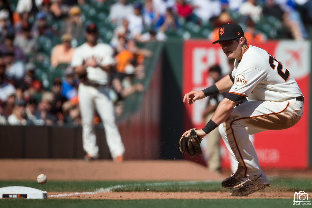 San Francisco Giants third baseman Christian Arroyo (22) fumbles a Los Angeles Dodgers ground ball at third base at AT&T Park in San Francisco, California, on April 27, 2017. (Stan Olszewski/Special to S.F. Examiner)