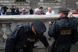 London, UK. 9th June, 2018. Supporters of Tommy Robinson, former leader of the far-right English Defence League, hurl abuse at anti-fascist counter-protesters in Parliament Street during the March for Tommy Robinson.
