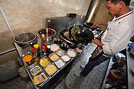 Restaurant cook, woking up a tasty Chinese lunch meal, Xu Wen, Guangdong province, China