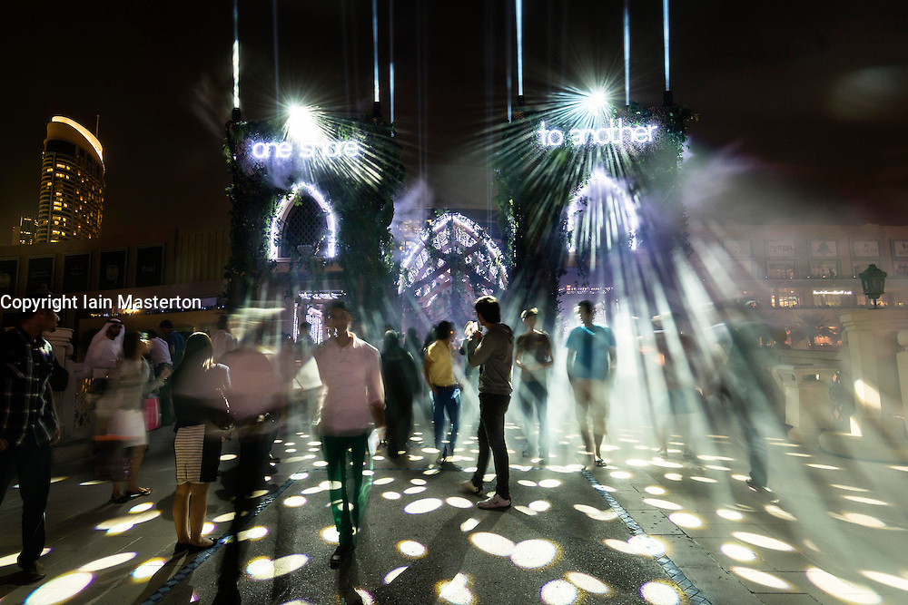 Mirage Metropolis light and sound installation by Jean-Charles de Castelbajac at opening night of  Dubai Festival of Lights 2014 held in Downtown Dubai United Arab Emirates