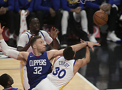 January 6, 2018 - Los Angeles, California, U.S - Blake Griffin #32 of the Los Angeles Clippers blocks Stephen Curry #30 of the Golden State Warriors during their NBA game on Saturday January 6, 2018 at the Staples Center in Los Angeles, California. Clippers vs Warriors. (Credit Image: © Prensa Internacional via ZUMA Wire)