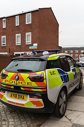 The house, behind the police car, at Knights Close in Hackney where police were called to a domestic incident where a man was said to be making threats with a knife and was subsequently shot, sustaining life-threatening injuries, whilst one police officer suffered a knife wound. London, March 20 2019.