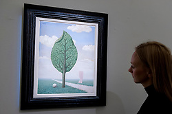 "© Licensed to London News Pictures. 08/04/2016. London, UK. A Sotheby's staff member views René Magritte's ""La Geante"", 1936, est. $1.4-1.8million.  Sotheby's auction preview, at their New Bond Street gallery, of works to be in the upcoming New York Impressionist, modern and contemporary art sale. Photo credit : Stephen Chung/LNP"