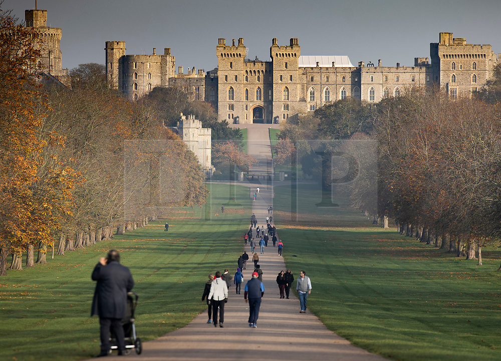 © Licensed to London News Pictures. 07/11/2020. Windsor, UK. People exercise on The Long Walk in sight of Windsor Castle during a misty cold morning.  Photo credit: Peter Macdiarmid/LNP