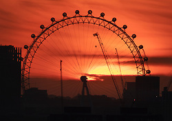 © Licensed to London News Pictures. 23/08/2019. London, UK. The sun sets behind the London Eye on the London skyline after a hot August day. Record high temperatures are expected in parts of the United Kingdom over the three day bank holiday weekend. Photo credit: Peter Macdiarmid/LNP