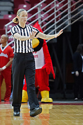 03 January 2014:  Referee Lisa Mattingly reports an infraction during an NCAA women's basketball game between the Drake Bulldogs and the Illinois Sate Redbirds at Redbird Arena in Normal IL