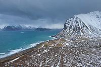 Winter view over coastal village of Myrland and surrounding mountain peaks, Flakstadøy, Lofoten Islands, Norway