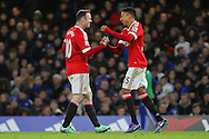 Jesse Lingard of Manchester United shakes hands with Wayne Rooney of Manchester United and celebrates after his goal during the Barclays Premier League match between Chelsea and Manchester United at Stamford Bridge, London, England on 7 February 2016. Photo by Phil Duncan.