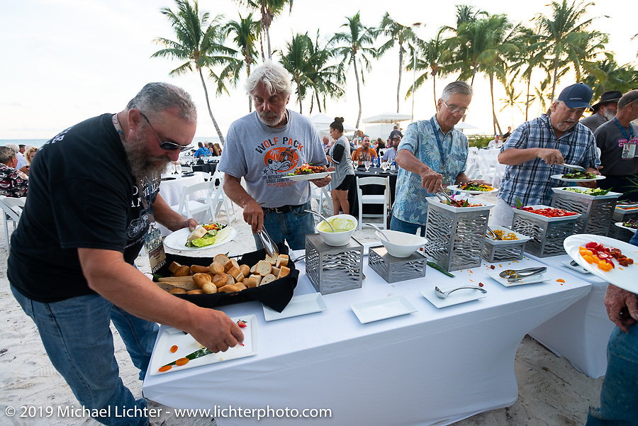 Matt Miller (L) and Frank Westfall at the last supper of the Cross Country Chase motorcycle endurance run from Sault Sainte Marie, MI to Key West, FL. (for vintage bikes from 1930-1948). The Awards Banquet on the beach at Casa Marina resort was a great way to wrap the 2,368 mile ride of the Cross Country Chase. Sunday, September 15, 2019. Photography ©2019 Michael Lichter.
