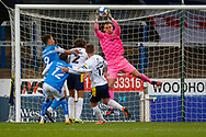 Oxford United goalkeeper Simon Eastwood (1) saves ahead of Peterborough Utd Forward Jonson Clarke-Harris (9)& Peterborough Utd Midfielder Reece Brown (12) during the EFL Sky Bet League 1 match between Peterborough United and Oxford United at London Road, Peterborough, England on 17 October 2020.