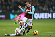Gareth McAuley of West Bromwich Albion tackles  Manuel Lanzini of West Ham United. Premier league match, West Ham Utd v West Bromwich Albion at the London Stadium, Queen Elizabeth Olympic Park in London on Saturday 11th February 2017.<br /> pic by John Patrick Fletcher, Andrew Orchard sports photography.