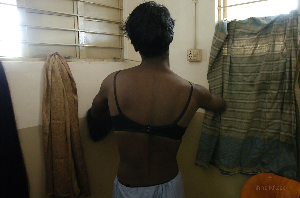 """A transgender puts on her cloth in Villupuram, India. As transgenders,""""hijras"""" in local terms, are acutely marginalized in Indian society, the major earning avenues for them are sex work, begging and performing at rituals."""