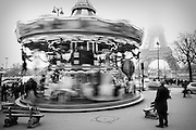 A carrousel turning by the Eiffel Tower in Paris