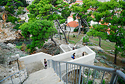 Elevated view of people descending steps from Fortress Lovrinjenac (Fort of Saint Lawrence), Dubrovnik old town, Croatia