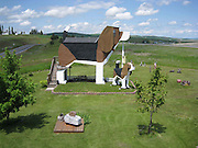 """The Beagle-Shaped Guesthouse<br /> <br /> Cottonwood, Idaho is home to Dog Bark Park Inn, a bed and breakfast-style guesthouse shaped like a giant beagle. Its unique shape, created by its wood-carving owners Dennis and Frances, is reminiscent of roadside tourist attractions from early car travel days. The artistic couple makes and sells chainsaw sculptures on site and the """"World's Biggest Beagle"""" guesthouse can be reserved for up to 4 people. <br /> ©Exclusivepix"""