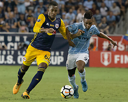 September 20, 2017 - Kansas City, Kansas, U.S - Sequence 01-02: Sporting KC forward Latif Blessing #9 (r) is on offense against NY Red Bulls defender Michael Amir Murillo #62 (l) during the first half of the game. Sporting KC will win the 2017 Lamar Hunt Open Cup championship with a score of 2-1 over the New York Red Bulls. (Credit Image: © Serena S.Y. Hsu via ZUMA Wire)