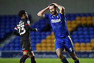 AFC Wimbledon striker Ollie Palmer (9) with both hands on head during the EFL Sky Bet League 1 match between AFC Wimbledon and Lincoln City at Plough Lane, London, United Kingdom on 2 January 2021.