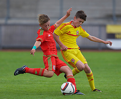 NEWPORT, WALES - Thursday, August 4, 2016: Regional Development Boys' Marcus Bank [L] and North Wales Academy Boys' Dylan Morgan [R] during the Welsh Football Trust Cymru Cup 2016 at Newport Stadium. (Pic by Paul Greenwood/Propaganda)<br /> <br /> North Boys (Yellow) v Regional Boys (Red)<br /> Marcus Bank Dylan Morgan