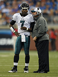 DETROIT - SEPTEMBER 19: Quarterback Michael Vick #7 of the Philadelphia Eagles talks with assistant Head Coach/offensive Coordinator Marty Mornhinweg during the game against the Detroit Lions on September 19, 2010 at Ford Field in Detroit, Michigan. The Eagles won 35-32. (Photo by Drew Hallowell/Getty Images)  *** Local Caption *** Michael Vick;Marty Mornhinweg