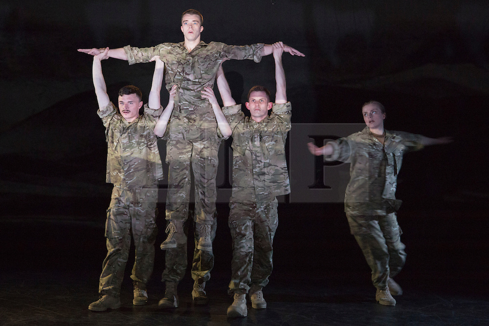 """© Licensed to London News Pictures. 07/05/2015. London, England. The company perform the Helicopter Dance. The Rosie Kay Dance Company perform """"5 Soldiers: The Body is the Frontline"""" at The Rifles Officers' Club in Mayfair, London from 7 to 9 May 2015 before continuing a UK tour. 5 Soldiers gives an intimate view of the training that provides soldiers for combat and warfare and how the experience affects those that put their life on the line. Dancers: Duncan Anderson, Shelley Eva Haden, Chester Hayes, Sean Marcs and Oliver Russell. Choreographed and directed by Rosie Kay.  Photo credit: Bettina Strenske/LNP"""