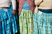 Bolivia June 2013. Cajamarca. Meeting with women...close up of pleated skirts.