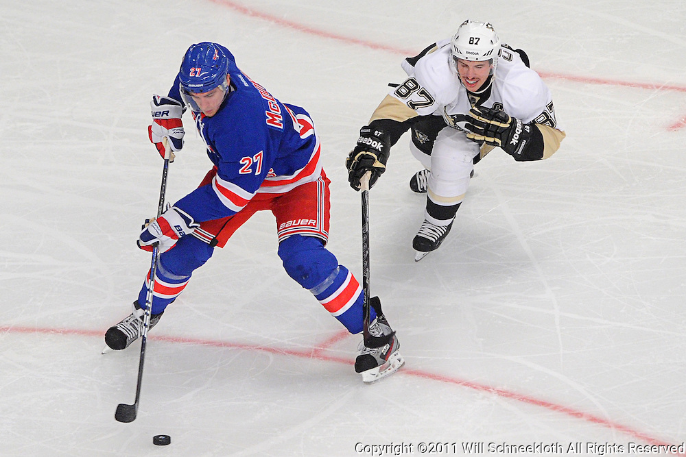 New York Rangers defenseman Ryan McDonagh (27) controls the puck away from the stick-check of Pittsburgh Penguins center Sidney Crosby (87) during second period NHL action between the New York Rangers and Pittsburgh Penguins at Madison Square Garden in New York, NY. The Rangers lead the Pengins 4-2 in the second intermission.