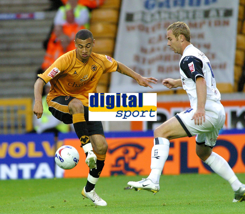 Photo: Dave Linney.<br />Wolverhampton Wanderers v Preston North End. Coca Cola Championship. 11/08/2006.Wolves Craig Davis(L) keeps conntrol as  Liam Chivers closes in