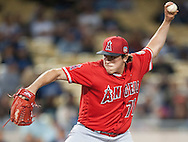 The Angels' Greg Mahle pitches during the Angels' Freeway Series game against the Dodgers Thursday night at Dodger Stadium.<br /> <br /> ///ADDITIONAL INFO:   <br /> <br /> freeway.0401.kjs  ---  Photo by KEVIN SULLIVAN / Orange County Register  --  3/31/16<br /> <br /> The Los Angeles Angels take on the Los Angeles Dodgers at Dodger Stadium during the Freeway Series Thursday.<br /> <br /> <br />  3/31/16