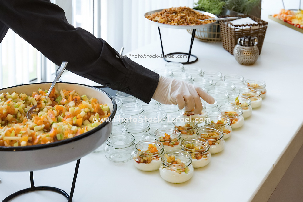 Freshly cut and sliced fruit as a health dessert at a banquet