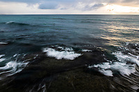 Waves breaking along the coastline at dawn, Arniston, Western Cape, South Africa,