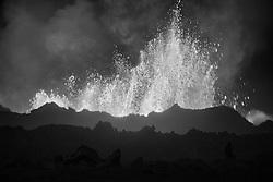 Man standing close to the volcano eruption at Holuhraun, highlands of Iceland -  - Eldgos við Holuhraun, maður skammt frá eldgosinu
