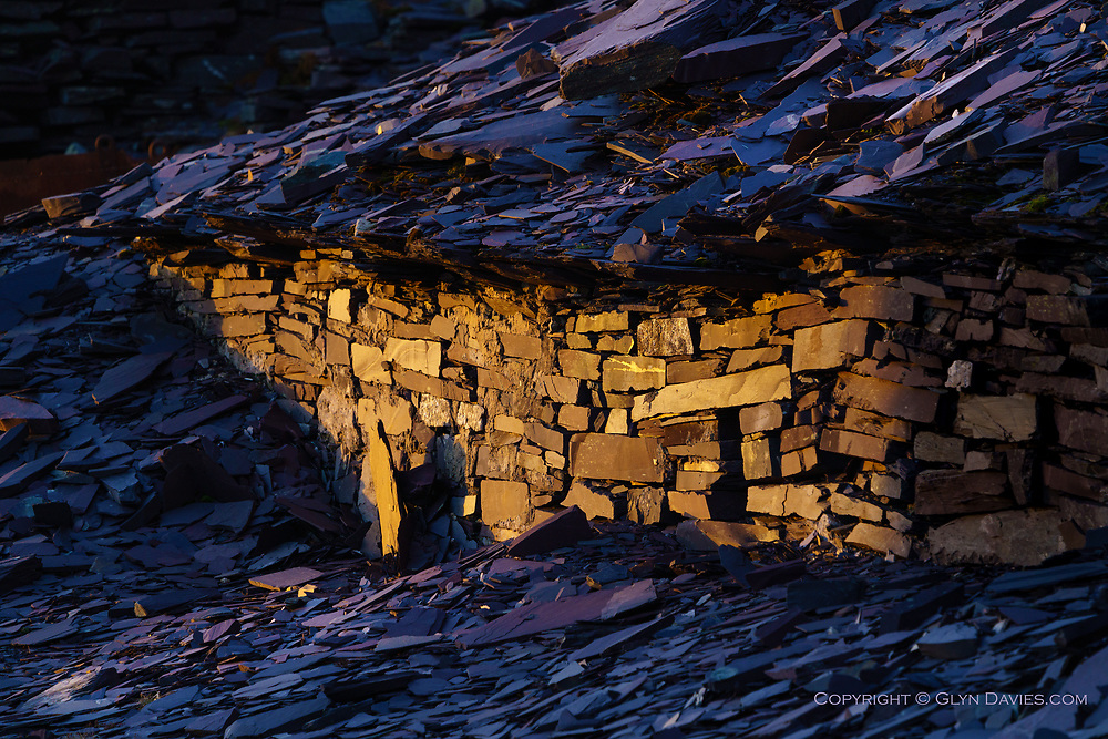 UNESCO World Heritage Site<br /> <br /> At dusk, the last shreds of evening sun illuminated a low wall desperately trying to hold back a mountain-sized flood of waste slate. It seemed curiously futile but in the beautiful light I also saw how the rough structure has done it's job for decades, against all odds