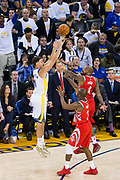 Golden State Warriors guard Klay Thompson (11) shoots a three pointer against the Houston Rockets at Oracle Arena in Oakland, Calif., on October 17, 2017. (Stan Olszewski/Special to S.F. Examiner)