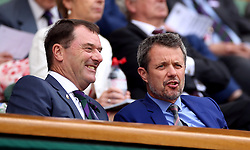 Crown Prince Frederik of Denmark and Chairman of the AELTC Philip Brook (left) in the royal box of centre court on day one of the Wimbledon Championships at the All England Lawn Tennis and Croquet Club, Wimbledon.