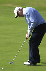 American Arnold Palmer putting on the sixth green during his second round at the Senior British Open Championship at Turnberry.