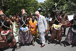The Prince of Wales is greeted by traditional dancers as he arrives for a visit to Osu Castle, also known as Fort Christiansborg in Accra, Ghana, on day four of his trip to west Africa with the Duchess of Cornwall.