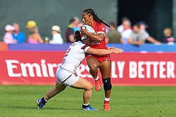 Charity Williams of Canada is tackled by Ilona Maher of USA <br /> <br /> Photographer Craig Thomas/Replay Images<br /> <br /> World Rugby HSBC World Sevens Series - Day 2 - Friday 6rd December 2019 - Sevens Stadium - Dubai<br /> <br /> World Copyright © Replay Images . All rights reserved. info@replayimages.co.uk - http://replayimages.co.uk