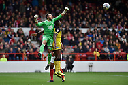 Nottingham Forest goalkeeper Jordan Smith (43) punches the ball away from Burton Albion striker Lucas Akins (10) during the EFL Sky Bet Championship match between Nottingham Forest and Burton Albion at the City Ground, Nottingham, England on 21 October 2017. Photo by Richard Holmes.