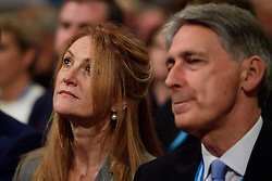 © Licensed to London News Pictures. Birmingham, UK.  Chancellor PHILIP HAMMOND and his wife SUSAN WILLIAMS WALKER attend the 2016 Conservative Party Conference. Photo credit: Ben Cawthra/LNP