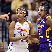 Nneka Ogwumike, (right), Los Angeles Sparks, and Alyssa Thomas, Connecticut Sun, both wearing face masks during the Connecticut Sun Vs Los Angeles Sparks WNBA regular season game at Mohegan Sun Arena, Uncasville, Connecticut, USA. 3rd July 2014. Photo Tim Clayton