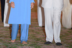 Detail view of the feet of the Prince of Wales and the Duchess of Cornwall as they visit Sheikh Zayed Grand Mosque in Abu Dhabi, United Arab Emirates, during the royal tour of the Middle East. Visitors to the mosque must remove their footwear, and Charles walked round in black socks while his wife went barefoot.