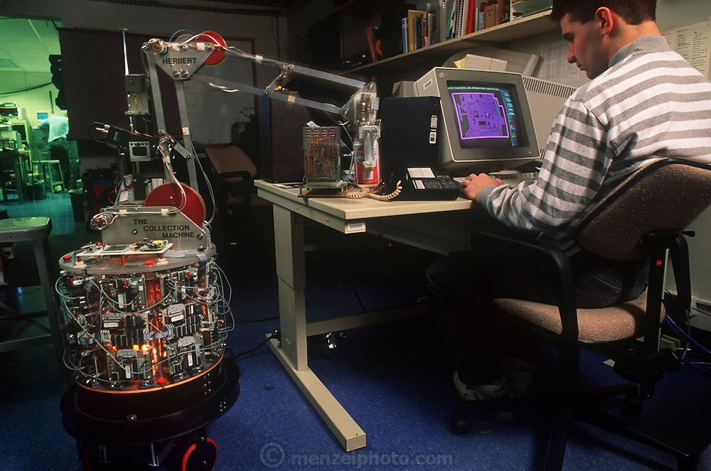 Chris Foley seen here with, Herbert, a robot that picks up empty soda cans, Insect Robot Lab, M.I.T., Cambridge, MA