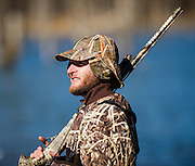Vance Fielder from Dewey, Oklahoma takes a break from duck hunting in Shamrock, Oklahoma