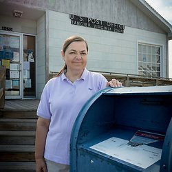 August 4, 2017 - Tangier Island, VA - Doloros Daley, the postmaster  of Tangier Island. <br /> Photo by Susana Raab/Institute