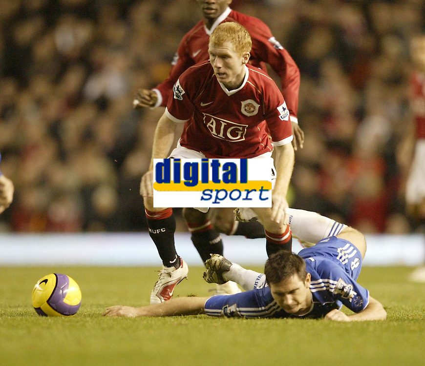 Photo: Aidan Ellis.<br /> Manchester United v Chelsea. The Barclays Premiership. 26/<br /> 2006.<br /> United's Paul Scholes sends Chelsea's Frank Lampard to the floor
