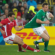 Tommy Bowe, Ireland, is tackled by Jamie Roberts, Wales, in action during the Ireland V Wales Quarter Final match at the IRB Rugby World Cup tournament. Wellington Regional Stadium, Wellington, New Zealand, 8th October 2011. Photo Tim Clayton...